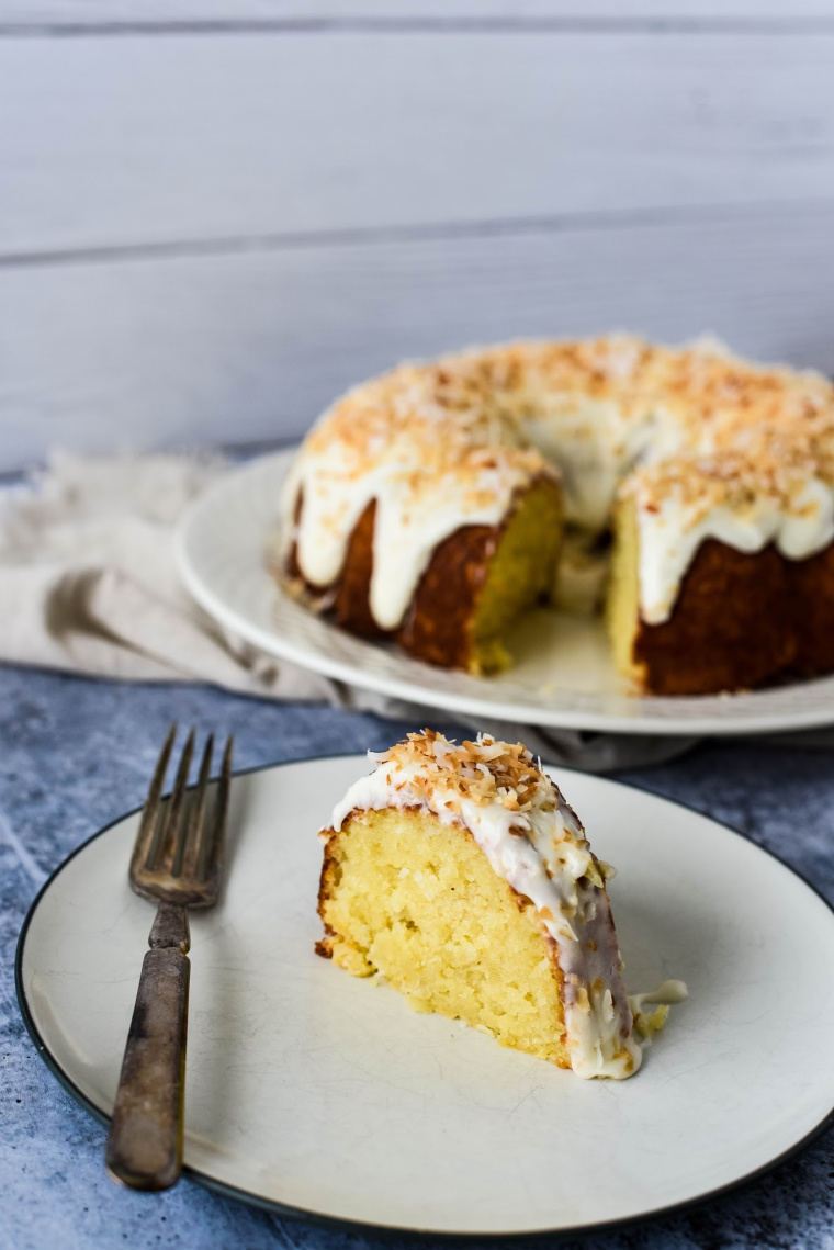 coconut bundt cake with slice on plate