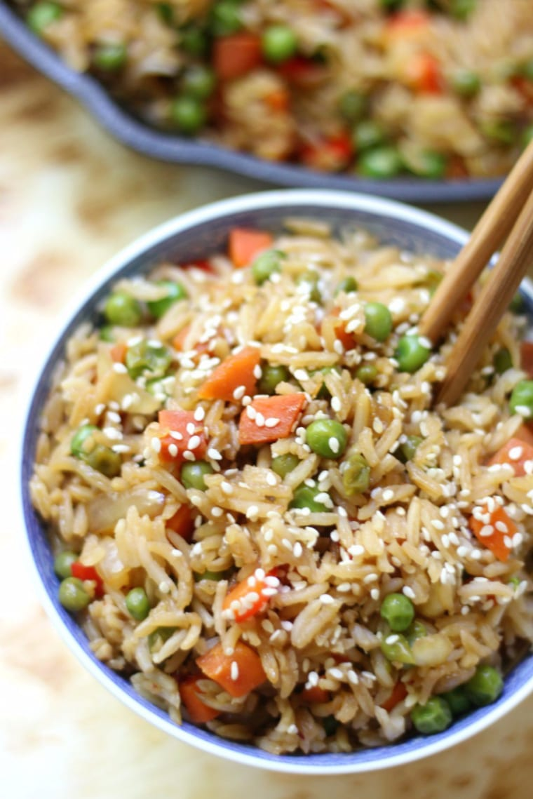 vegetable fried rice in bowl with chopsticks