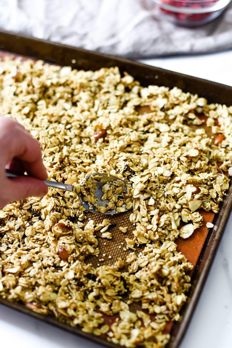stirring homemade granola on pan