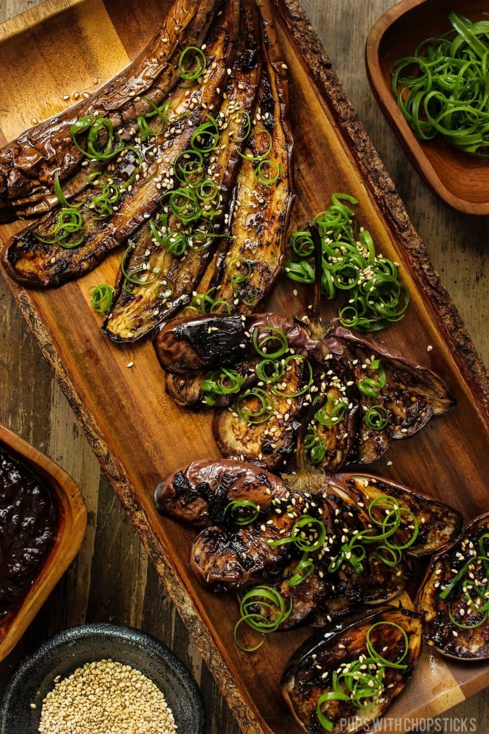 garlic roasted eggplant on wooden tray