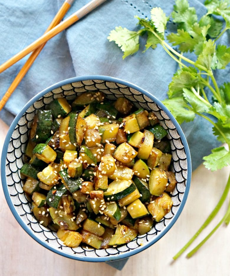 asian zucchini recipe in bowl with cilantro and chopsticks