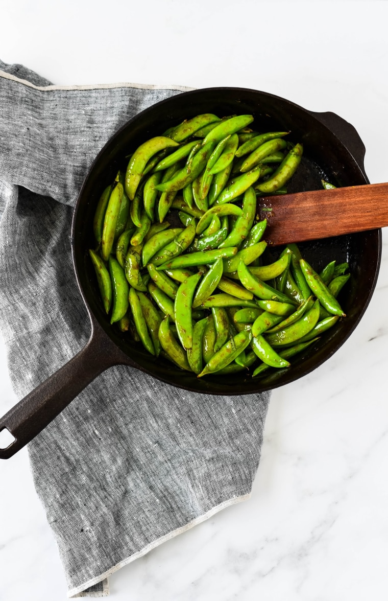 sugar snap peas in cast iron skillet