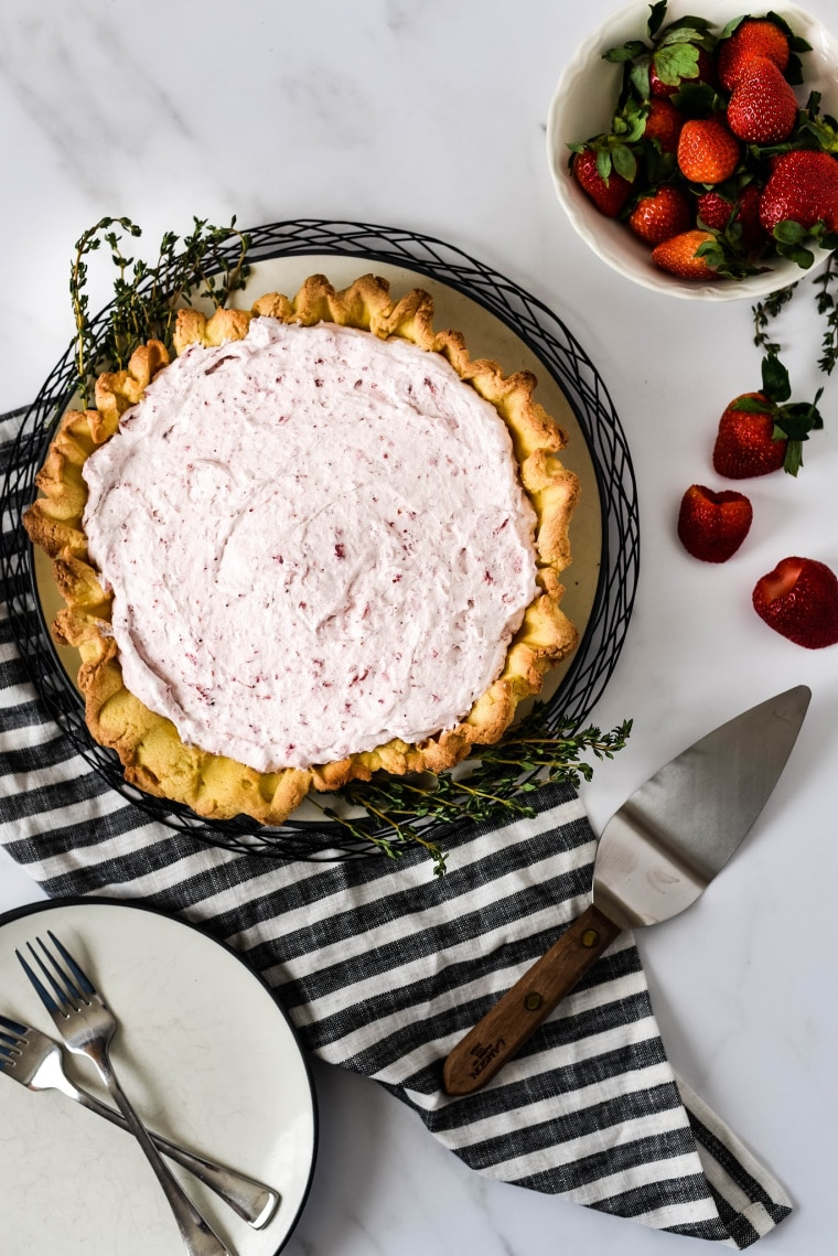 Roasted Strawberry Mousse Tart with plate and serving spatula