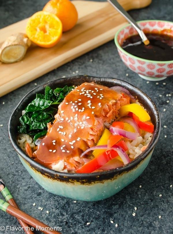 asian flavored salmon in bowl with veggies and rice