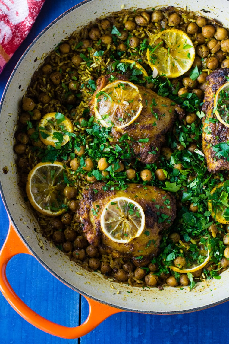 cooking pot with chicken and chickpeas with lemon