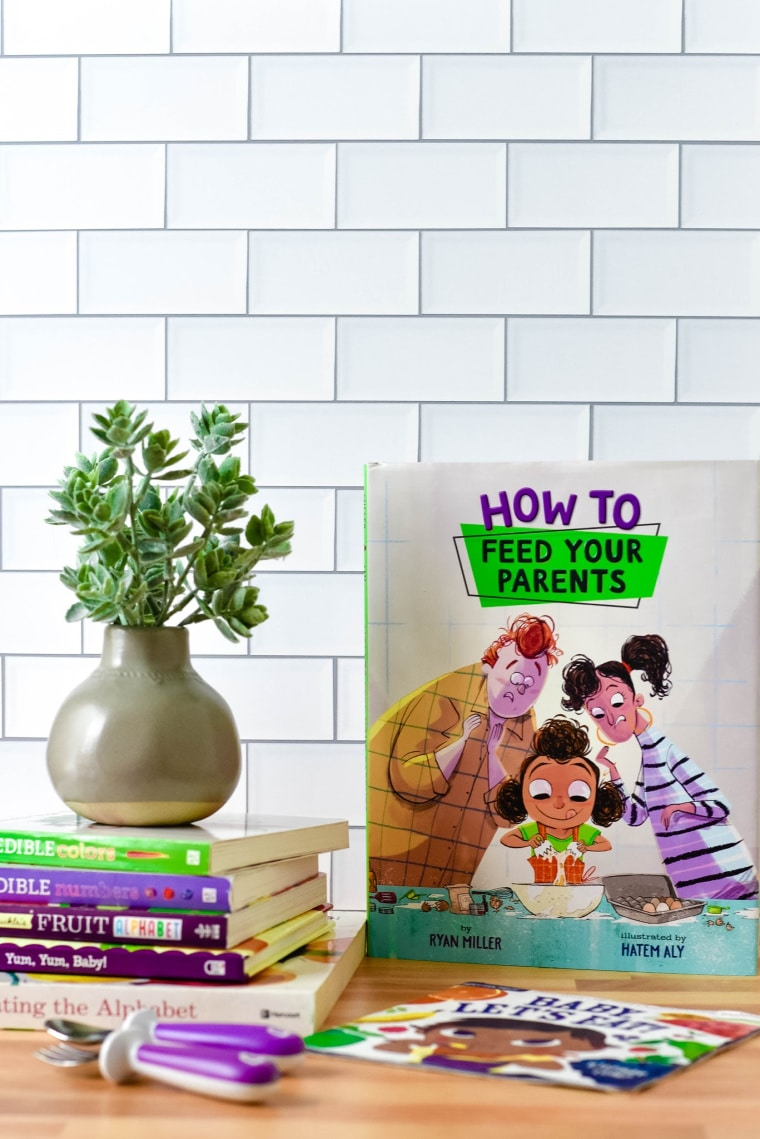 kids books on table with plant