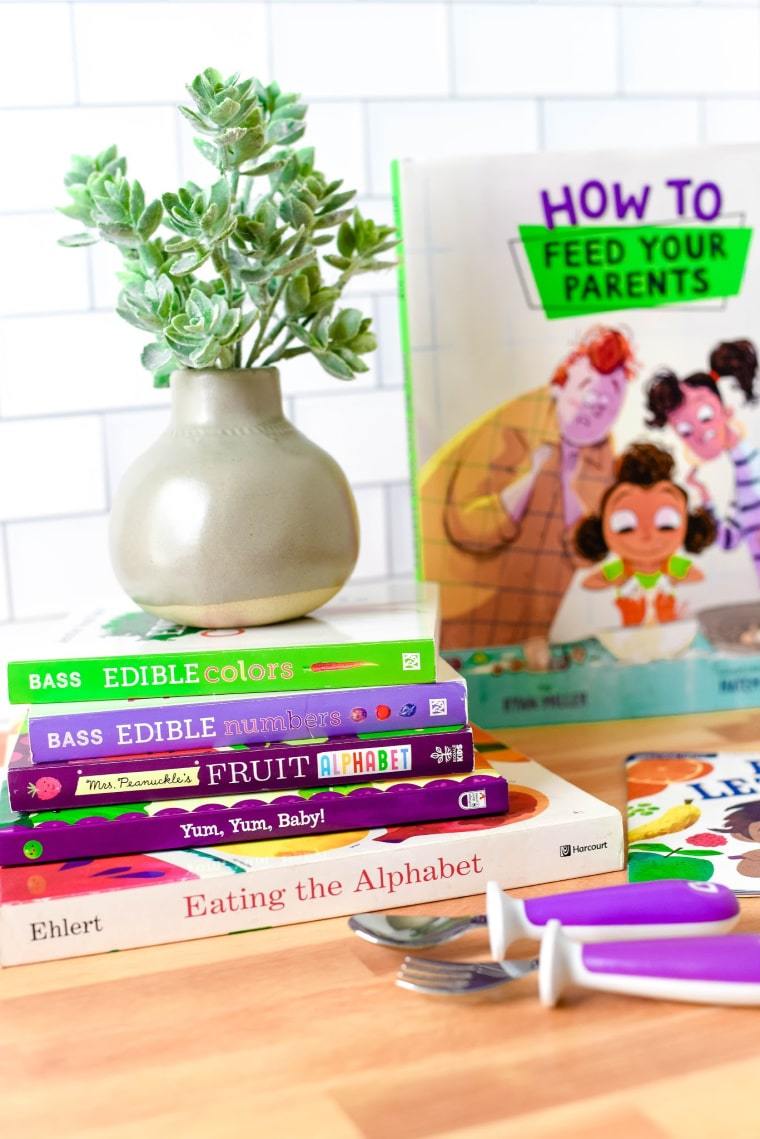 stack of kids books about food