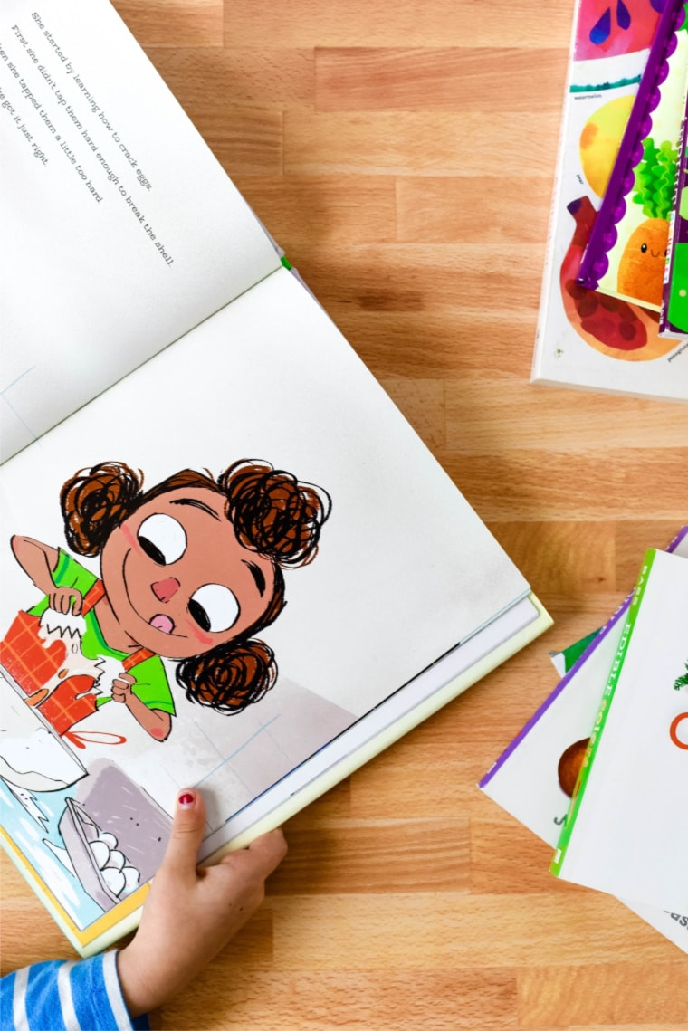 child reading book on table