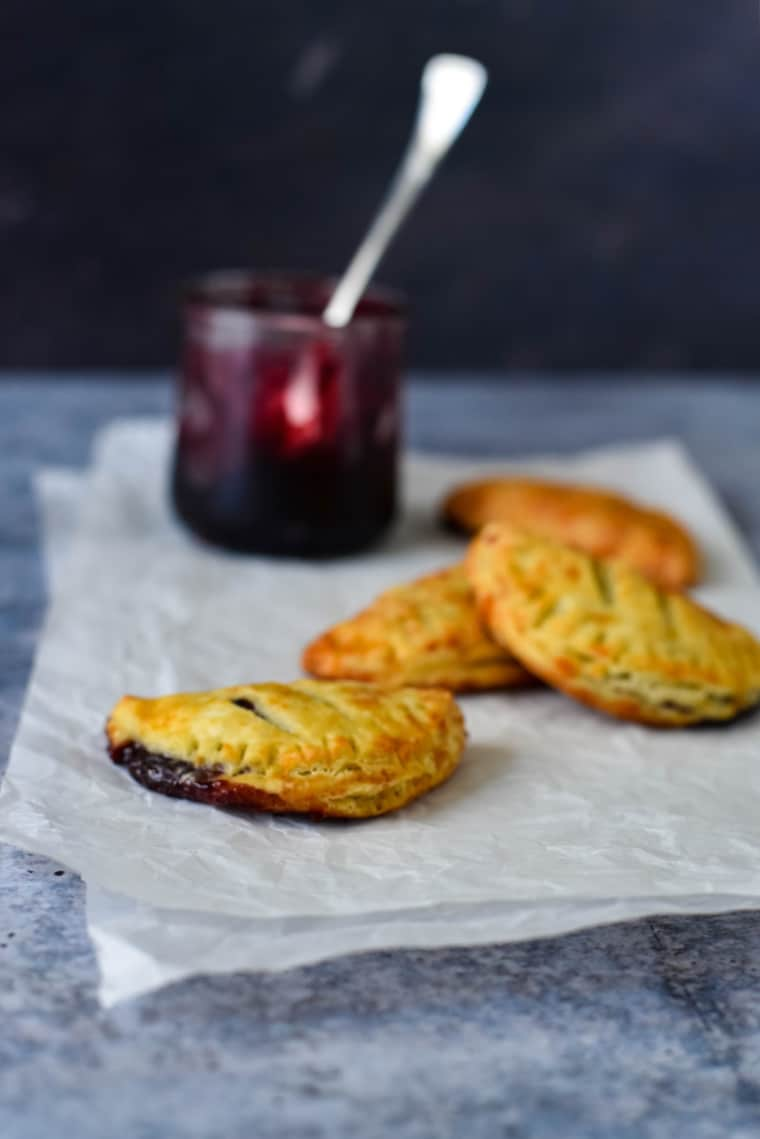 cheese jam turnovers on parchment paper with jam
