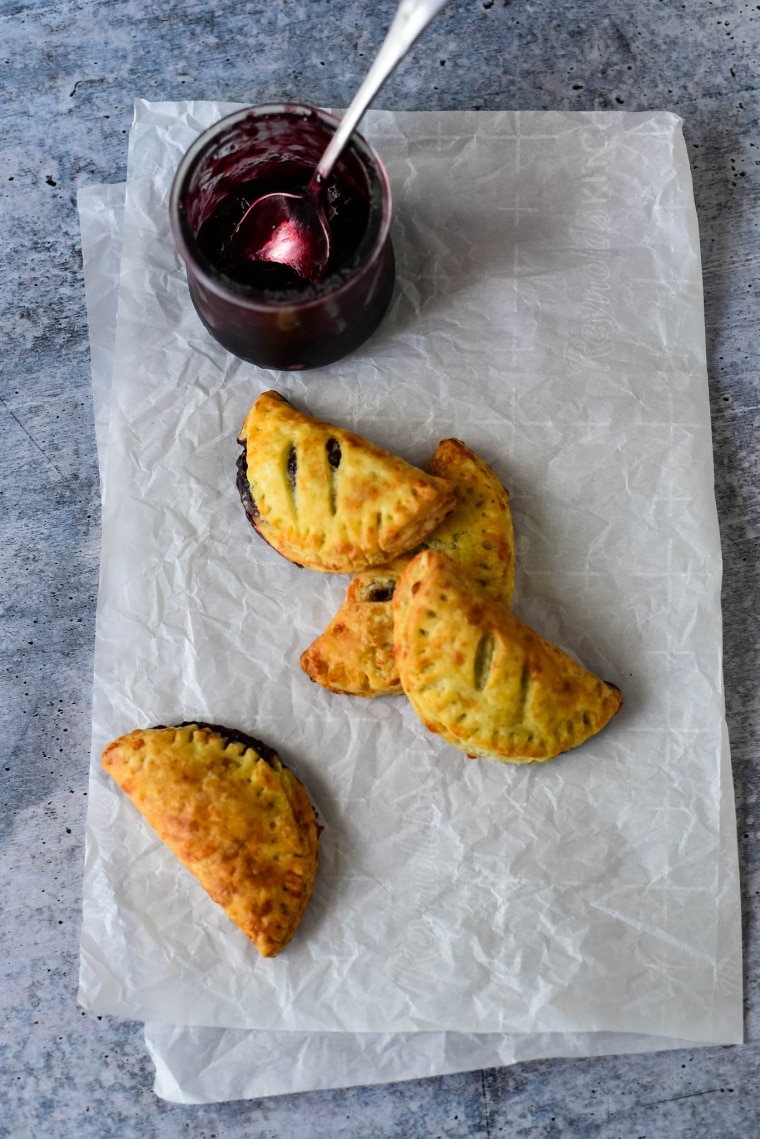 cheese and jam turnovers on paper