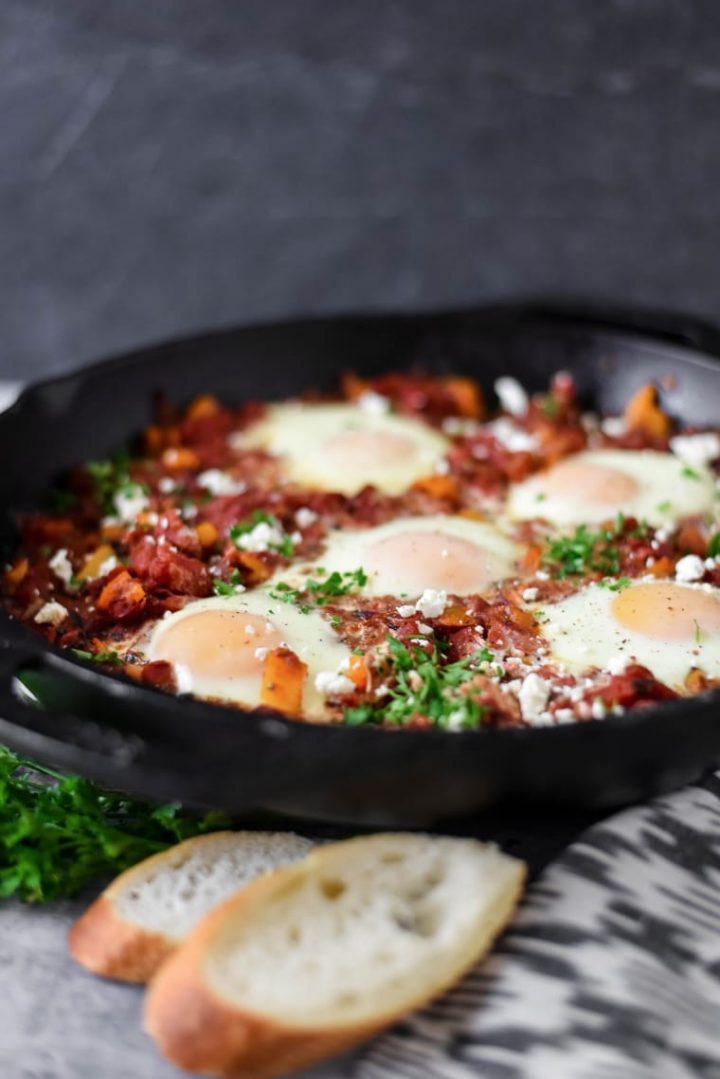 shakshuka in cast iron pan with bread