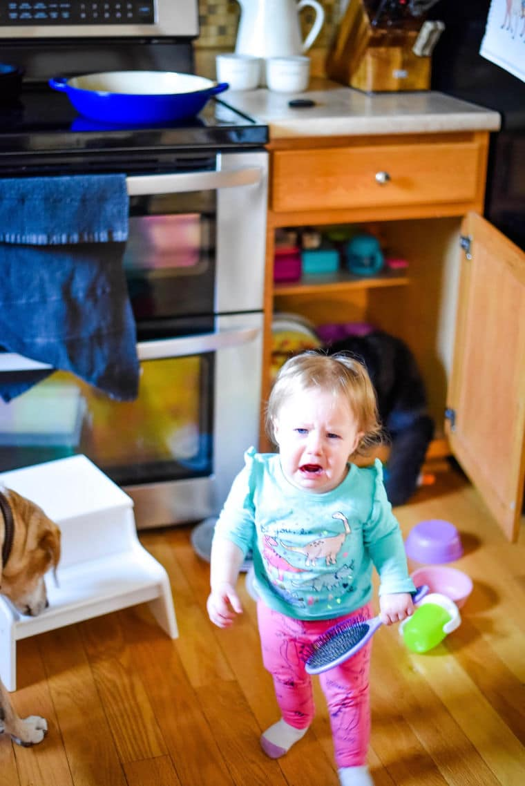 baby crying in kitchen