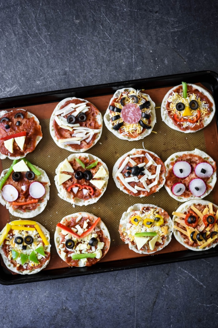 baking tray with halloween pizzas