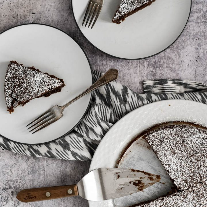 three pieces of Kladdkaka cake on white plates