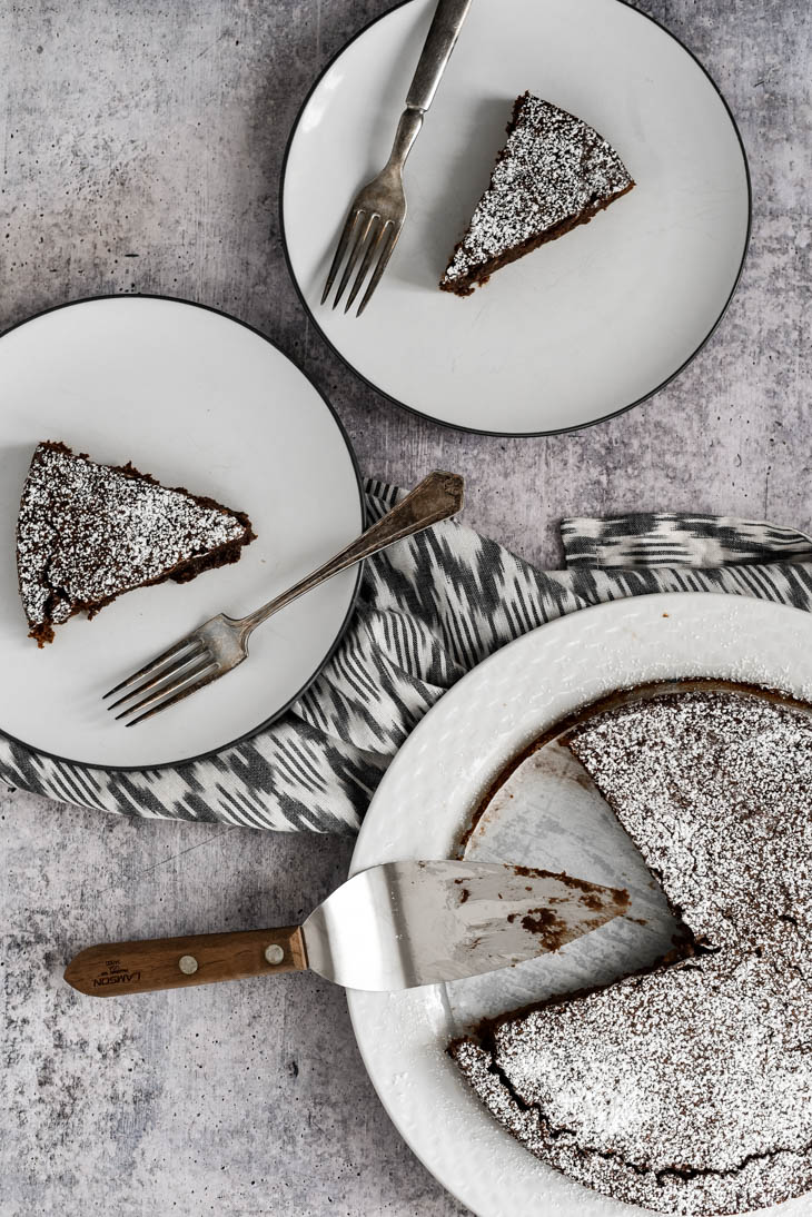 three pieces of Kladdkaka cake on white plates