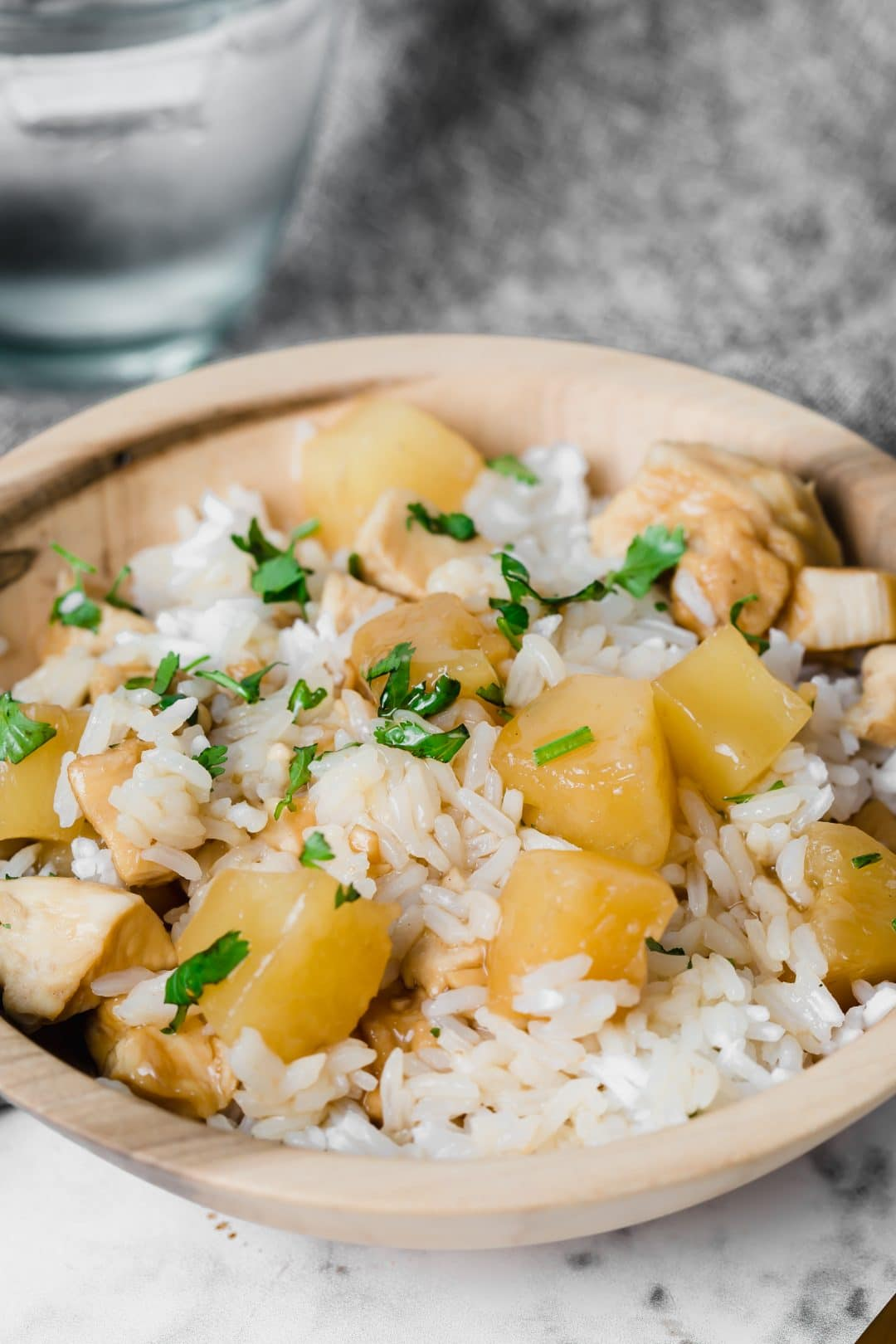 hawaiian pineapple chicken in wooden bowl