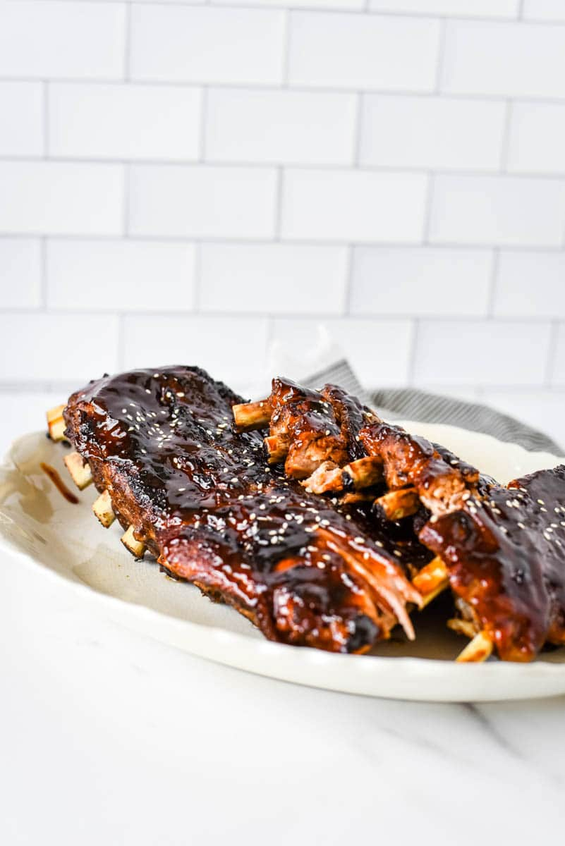 Asian Sticky Ribs on white platter