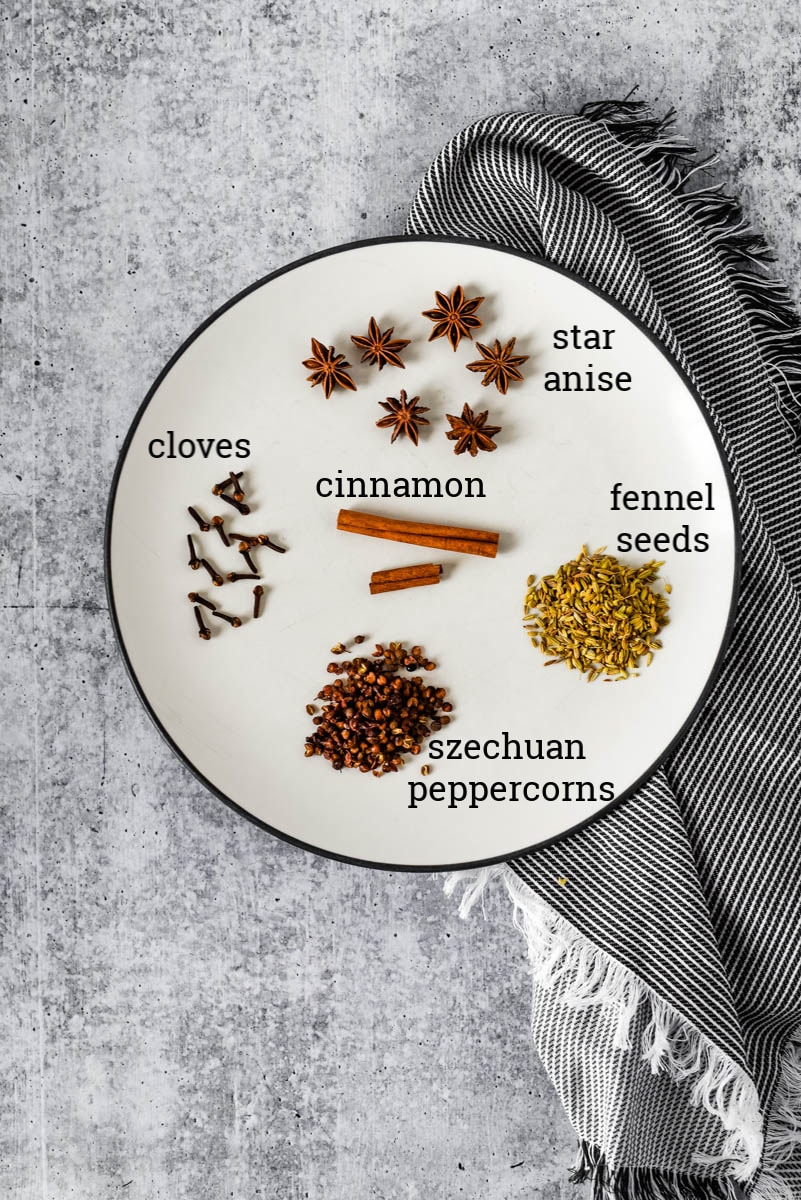 whole spices for Chinese Five Spice on plate with grey napkin