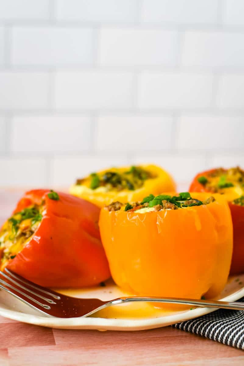 white plate with multi coloredd egg stuffed peppers