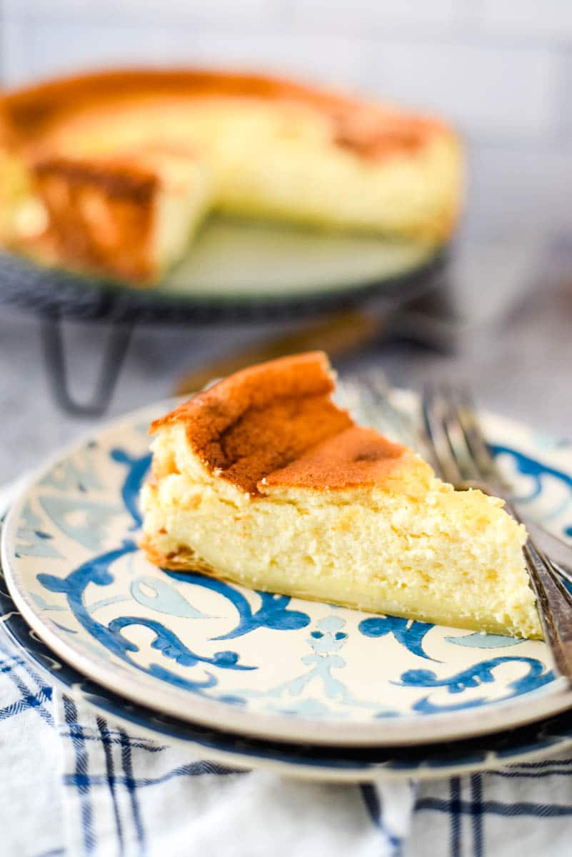 slice of fromage blanc tart on blue and white swirled plate