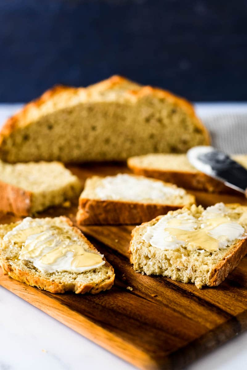 slices of sourdough irish soda bread smeared with butter and drizzled with honey