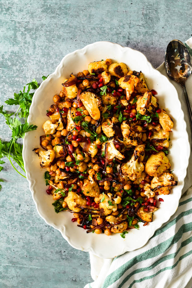 white platter with roasted cauliflower and onions and chickpeas