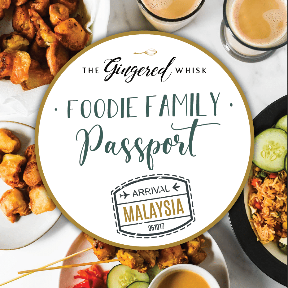 "A table topped with food from Malaysia with text overlay reading ""foodie family passport: Malaysia"""