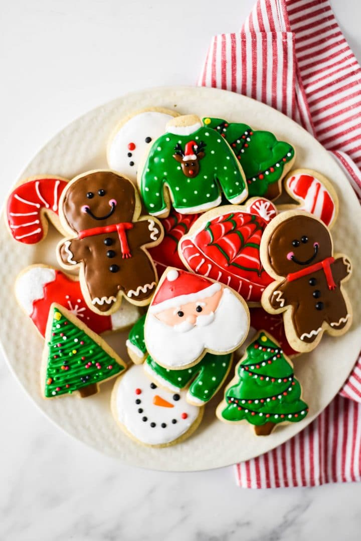 white plate filled with christmas decorated sugar cookies