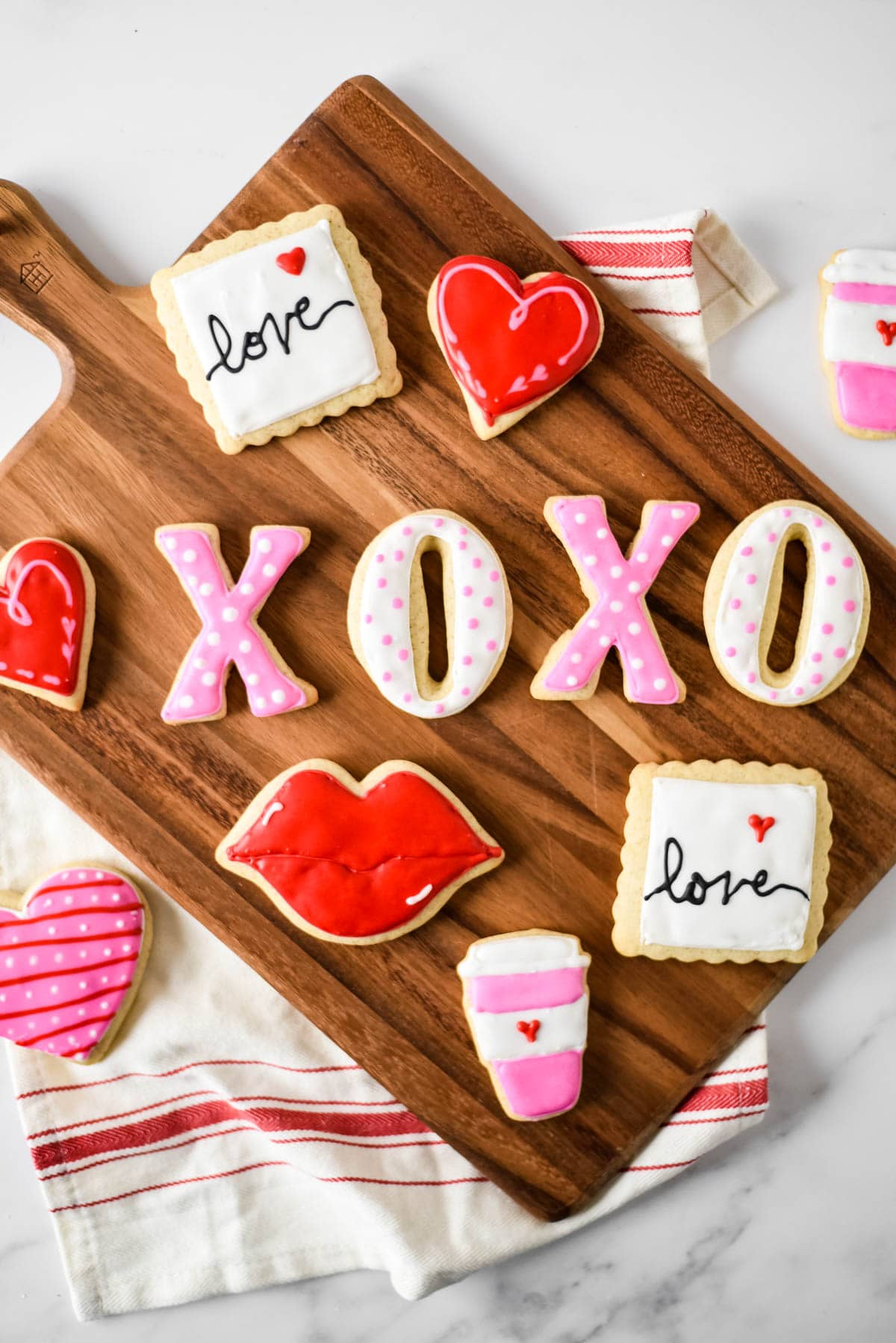 valentines day cut out cookies on wooden board