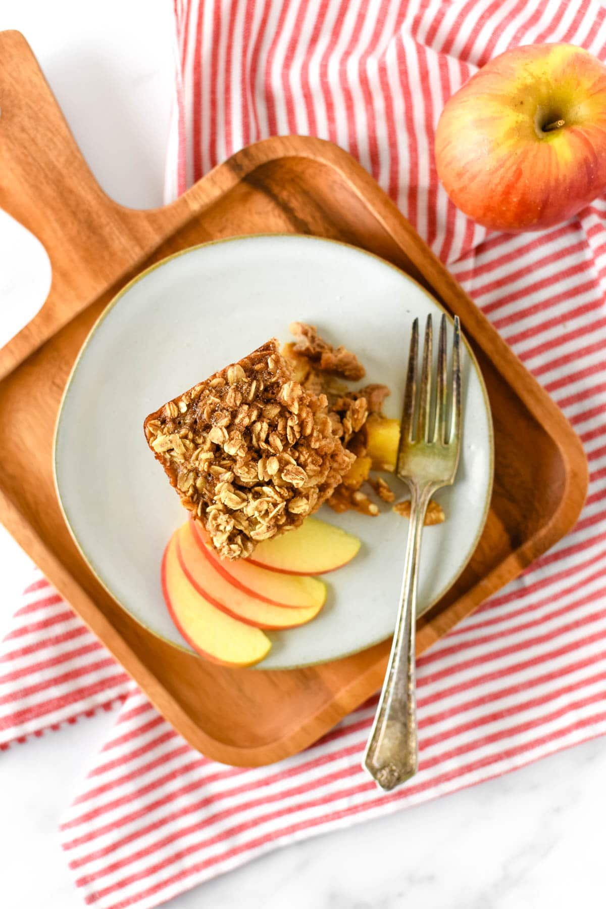 baked apple oatmeal on plate with fork