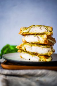 chicken grilled cheese sandwiches stacked on a plate
