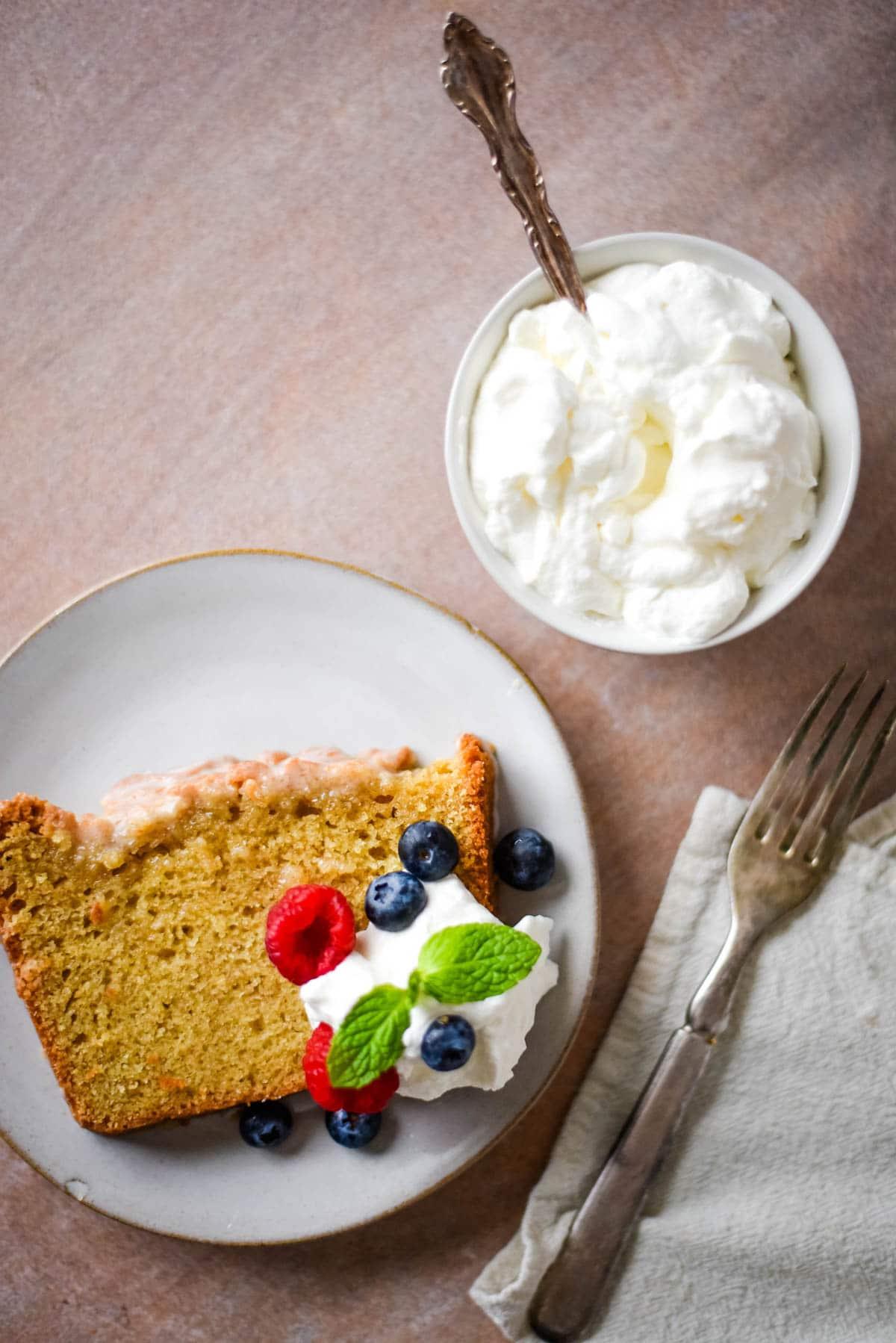 slice of pound cake next to whipped cream