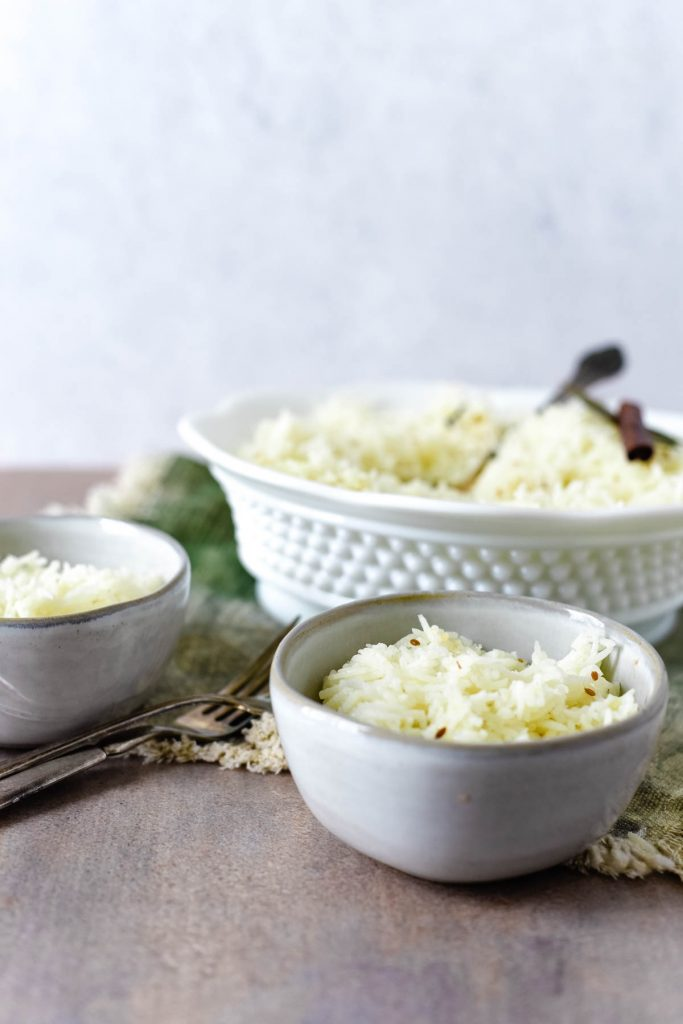 two small bowls filled with rice