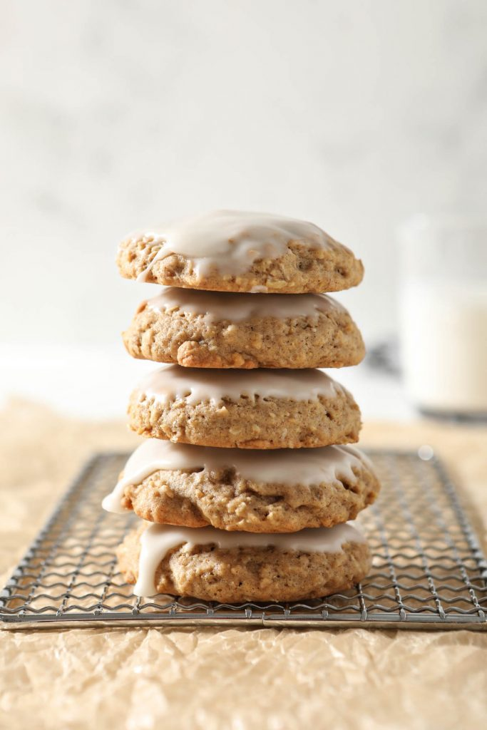 stack of five oatmeal cookies with icing