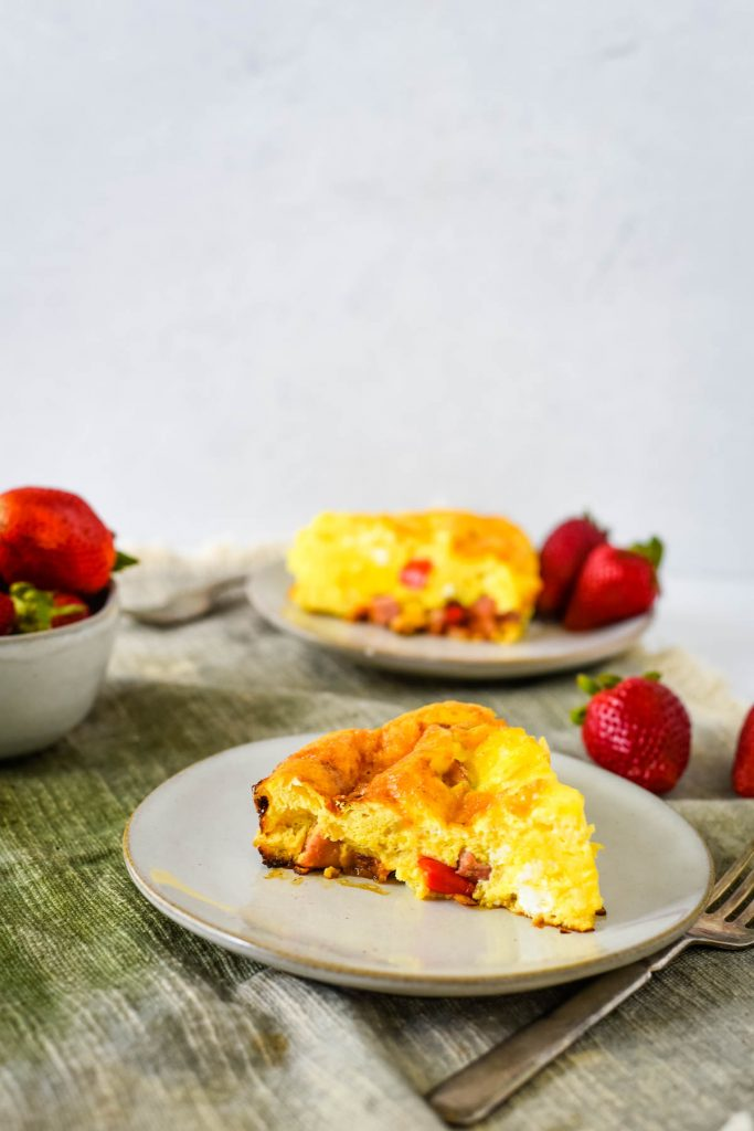 two plates with ham and cheese frittata