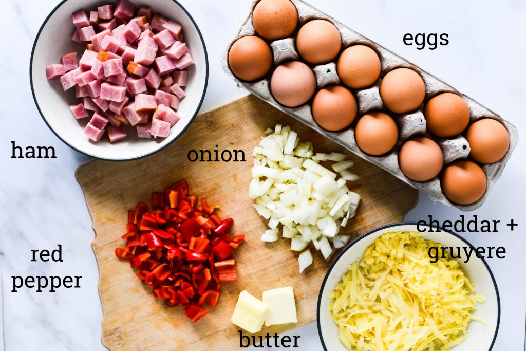 ingredients to make frittata - eggs, ham, cheese, onions, peppers, butter