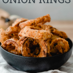 onion rings in bowl with text