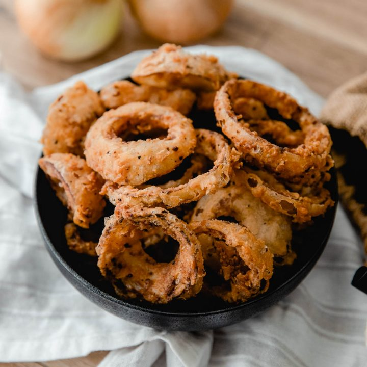 black bowl with sourdough onion rings