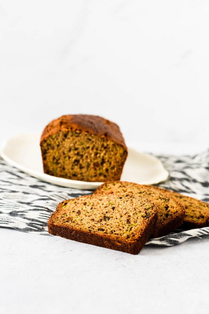 slices of zucchini bread by white platter