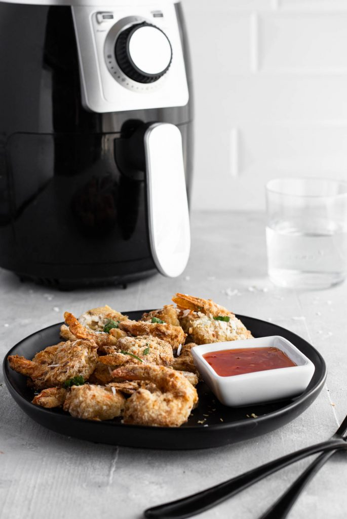 platter of shrimp with air fryer in background