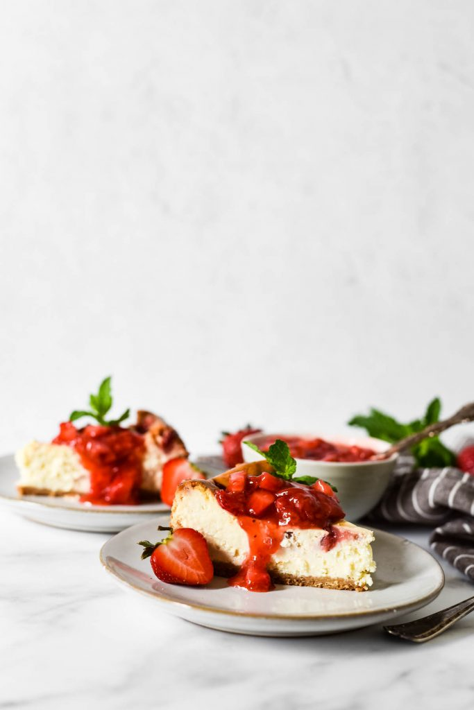 slice of cheesecake with strawberry topping