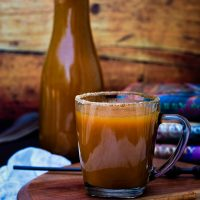 glass of harry potter pumpkin juice with pitcher and wand