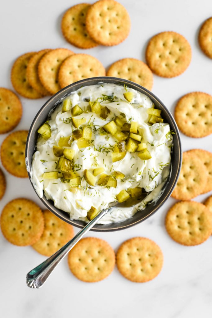 pickle dip in bowl surround by crackers