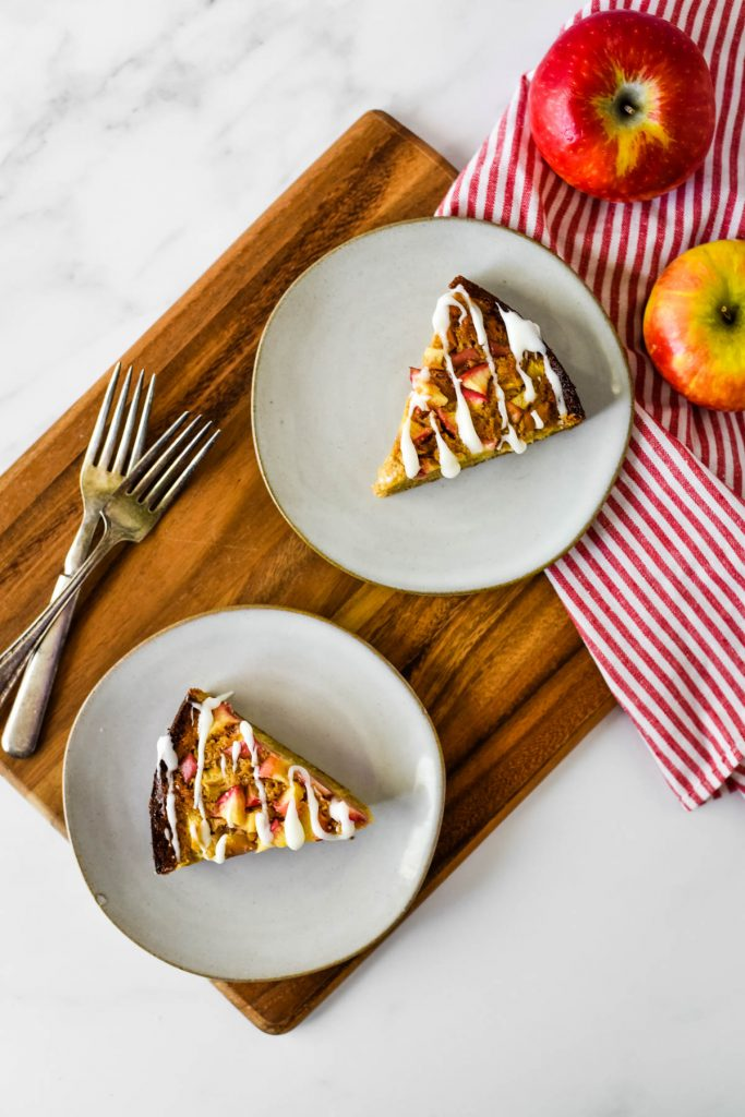 two slices of sourdough apple cake on grey plates