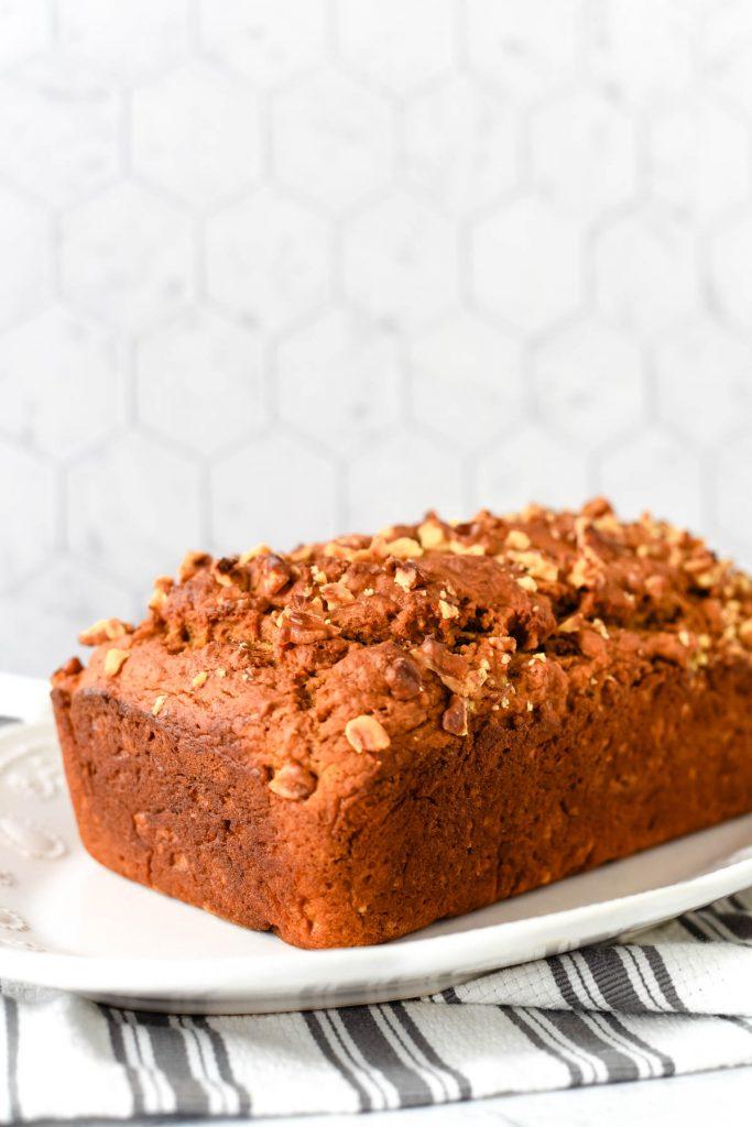 loaf of freshly baked quick bread on white platter