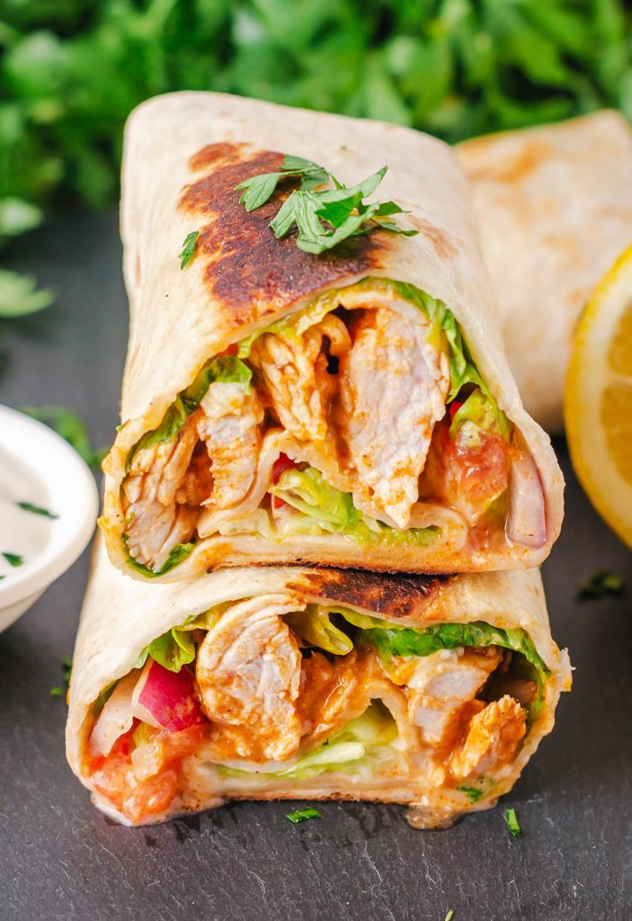 two chicken wraps stacked on top of each other