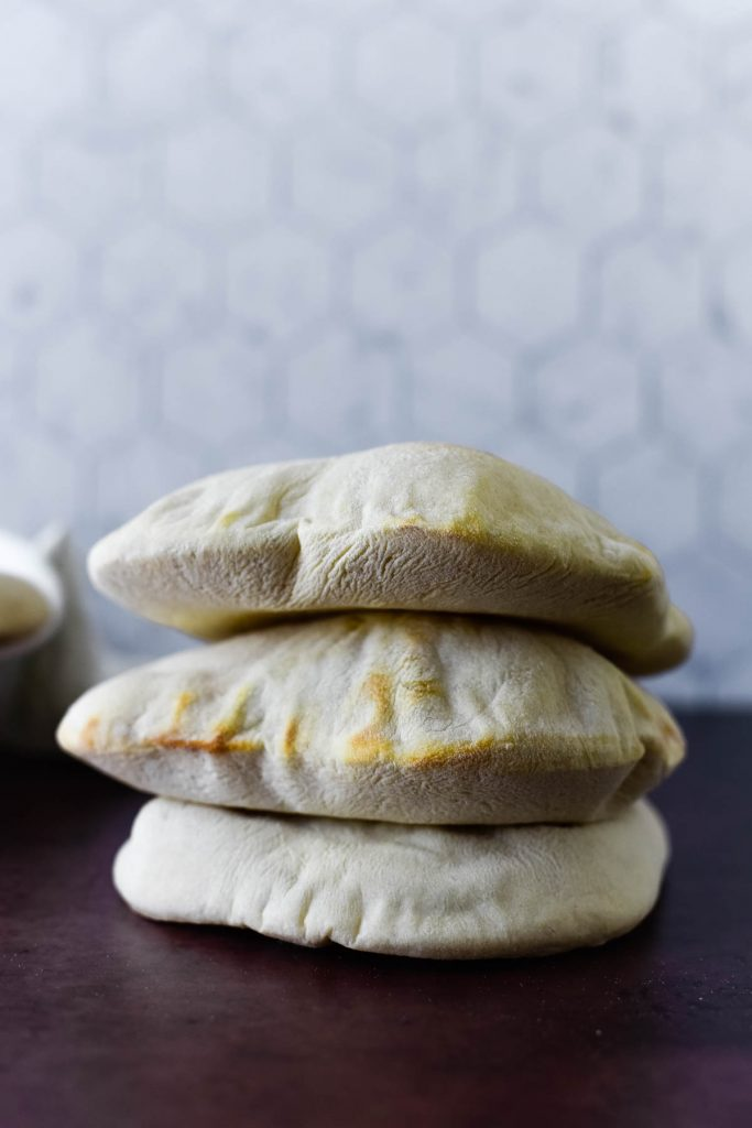 three puffy pita pockets stacked on top of each other